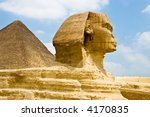 The sphinx in front of the great pyramid - stock photo