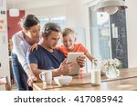 a modern family using a digital ... | Shutterstock . vector #417085942
