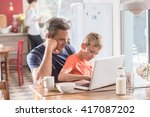 a father and son using a laptop ... | Shutterstock . vector #417087202