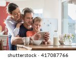 a modern family using a digital ... | Shutterstock . vector #417087766