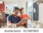 dad and his eight year old son... | Shutterstock . vector #417087805