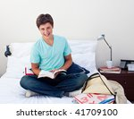 smiling teenager studying maths ... | Shutterstock . vector #41709100