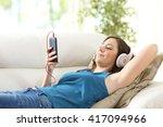 girl listening music with... | Shutterstock . vector #417094966