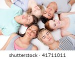 teens sleeping on floor with... | Shutterstock . vector #41711011