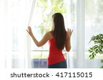 back view of a woman looking... | Shutterstock . vector #417115015