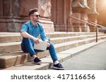 cheerful guy sitting on the... | Shutterstock . vector #417116656