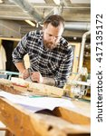 carpenter work with plane on... | Shutterstock . vector #417135172