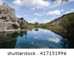 Small photo of Clouds reflect in a pond near Gunlock, Utah.