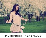 pretty young woman with pink...   Shutterstock . vector #417176938