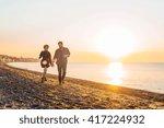 happy loving couple walking on... | Shutterstock . vector #417224932