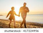 happy loving couple walking on... | Shutterstock . vector #417224956