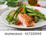 Stock photo baked salmon garnished with asparagus and tomatoes with herbs 417233545