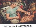 handsome pizzaiolo making pizza ... | Shutterstock . vector #417285856