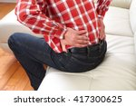 unhappy man suffering from... | Shutterstock . vector #417300625