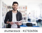 portrait of happy student while ... | Shutterstock . vector #417326506