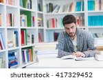 student reading book in library ... | Shutterstock . vector #417329452