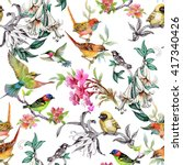 Stock photo watercolor hand drawn seamless pattern with tropical summer flowers and exotic birds on white 417340426