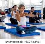 Group of people at a gym class with free-weights - stock photo