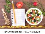 fresh greek salad with... | Shutterstock . vector #417435325
