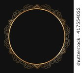 round gold lace border frame... | Shutterstock .eps vector #417554032