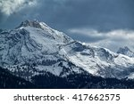 "View to the snowy mountains called ""Wetterstein"" with a dramatic clouded sky in Bavaria, Germany"