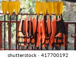 Small photo of soft focus of Life jacket or life vest or air jacket and paddle or oar