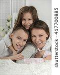 happy mother with kids  | Shutterstock . vector #417700885