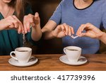 hands of two women putting... | Shutterstock . vector #417739396