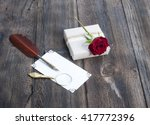 rose and gift on wooden board | Shutterstock . vector #417772396