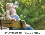 Elderly Couple Resting On A...