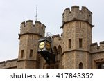 A Clock Adorning The Tower Of...