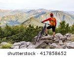 mountain biker looking at view... | Shutterstock . vector #417858652