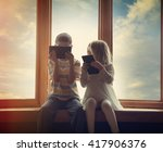 two children are sitting by the ... | Shutterstock . vector #417906376