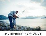 Son And Dad Fishing At Dam...