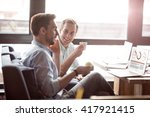positive colleagues sitting at... | Shutterstock . vector #417921415