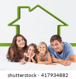 happy family lying on a bed... | Shutterstock . vector #417934882