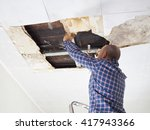 man repairing collapsed ceiling.... | Shutterstock . vector #417943366