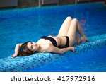girl lying near the pool. | Shutterstock . vector #417972916