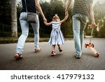 happy stylish parents holding... | Shutterstock . vector #417979132
