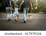 happy stylish parents holding...   Shutterstock . vector #417979156