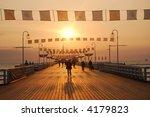 People Walking On Pier During...