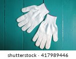 working cloth gloves on wooden... | Shutterstock . vector #417989446