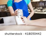 girl's hand paying money to... | Shutterstock . vector #418050442