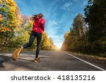 Lady Running Along The Road In...