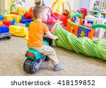 boy sitting on a toy motorcycle.... | Shutterstock . vector #418159852