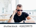 handsome man talking by mobile...   Shutterstock . vector #418159975