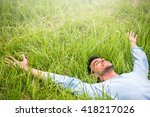 happy beautiful man lying on... | Shutterstock . vector #418217026