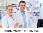 female and male pharmacists in... | Shutterstock . vector #418237456