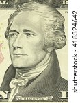 Small photo of Alexander Hamilton portrait on the banknote of ten American dollars closeup