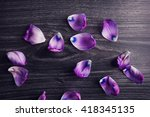 violet petals on gray wood with ... | Shutterstock . vector #418345135